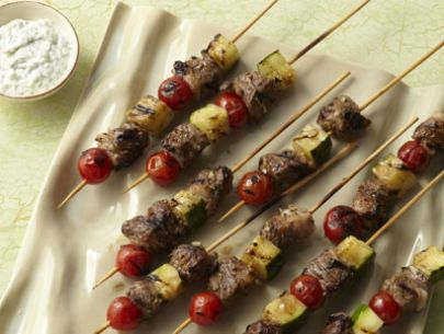 http://www.foodnetwork.com/recipes/food-network-kitchens/grilled-lamb-kebabs-with-tomatoes-zucchini-and-yogurt-sauce-recipe.html